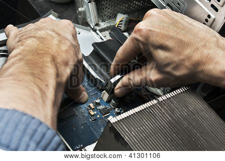 Repair, checking the computer. Two hands close up.