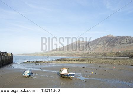 Trefor Beach, Wales. Two Small Fishing Boats At A Secluded Bay Near Snowdonia On The Llyn Peninsula