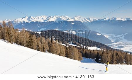 Ski Run And Snow Covered Alpine Peaks