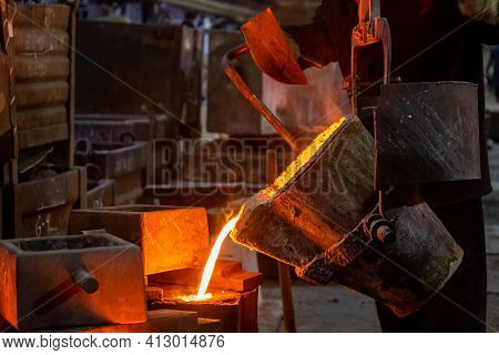 Industrial Chill Casting. The Process Of For Filling Out Mold With Molten Metal.