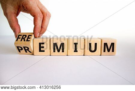 Premium Or Freemium Symbol. Businessman Turns The Wooden Cube And Changes The Word 'premium' To 'fre