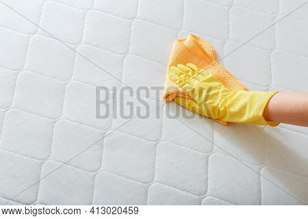 Employee Cleans Surface Of Mattress On Bed With Rag. Cleaning Disinfection Surfaces. Cleaning Compan