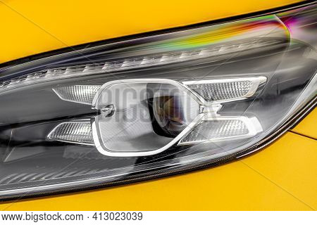 Headlight Lamp Of New Cars. Close Up Detail On One Of The Led Headlights Modern Yellow Car. Exterior