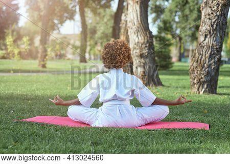 Afro American Girl Karateka Meditating In Park