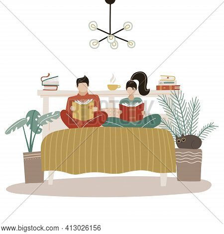 Young Loving Couple Spending Time Together In Bedroom, Reading Bedside Books, Sitting On Comfortable
