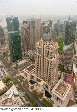 Shanghai, Pudong, Lujiazui, China - May 4, 2010: Beige Stone China Ping-an Finance Skyscraper With L