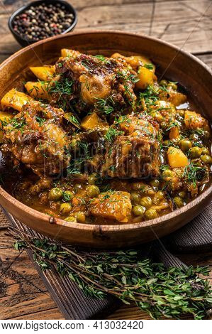 Veal Beef Oxtails Tails Stew With Vegetables In A Wooden Plate. Wooden Background. Top View