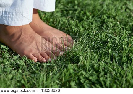 Barefoot Afro American Girl Standing On Green Grass