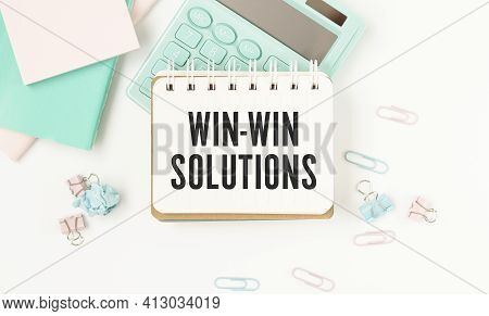 Text On Notepad Win-win Solutions On White Table.