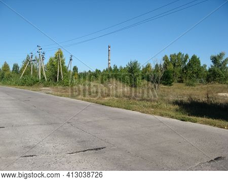 The Old Road Is Made Of Concrete Slabs. Road Surface Slabs Of Concrete.