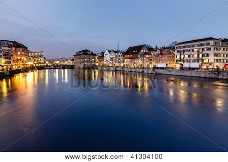 Illuminated Cityhall And Limmat River Bank In The Evening, Zurich, Switzerland