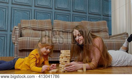 Mother Play Wooden Blocks Board Game With Little Daughter Child Girl At Home, Leisure Hobbies