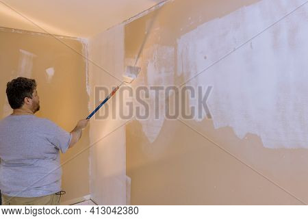 Renovation Of Interior, Male Hand Painting Wall With Paint Roller Painting Apartment, Renovating Wit