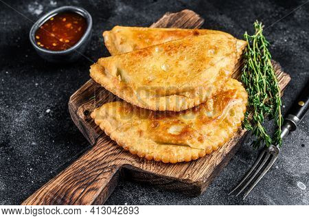 Mexican Chilean Food Fried Empanadas Pie With Beef Meat. Black Background. Top View