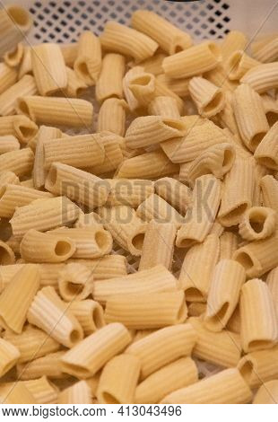Tray Of Handmade Rigatoni Pasta In An Italian Kitchen In A Restaurant.