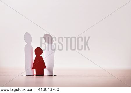 Concept Of Sexual Violence To Underage Girls With Paper Cutouts And Light Background On Wooden Table
