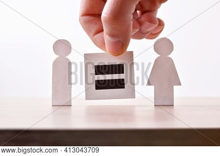 Equality Between Man And Woman Holding Hand Holding Sign With Equal Sign Between Two Paper Cutouts S