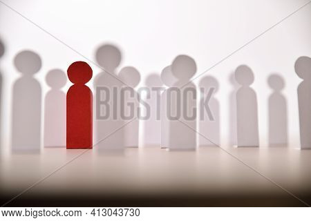 Social Discrimination Concept With Many Little Paper Men And A Different One On Wooden Base Front Vi
