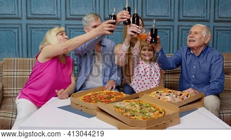Multigenerational Family Having Lunch Party, Eating Pizza Food, Laughing, Raising Toast At Home