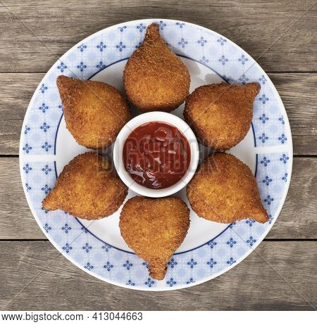 Typical Brazilian Snack Coxinha On A Plate With Ketchup.