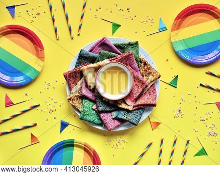 Rainbow Party, Table Setup. Vibrant Crepes On Plate With Honey. Party Table, Yellow Paper Tablecloth