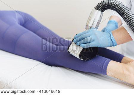 Young Woman Doing Lpg Leg Procedure. Advertising. Lymphatic Drainage Massage Lpg Apparatus Process.
