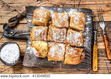 Greek Pastry Bougatsa With Phyllo Dough And Semolina Custard Cream. Wooden Background. Top View