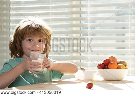 Child Eating Healthy Food. Close Up Of Cute Little Boy Kid Drink Tasty Organic Milk With Vitamins Ca