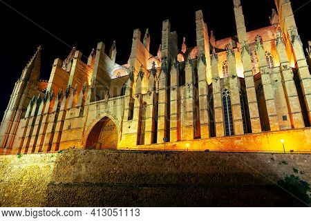 Gothic Cathedral In Palma De Mallorca Illuminated In The Night . Catedral Basilica De Santa Maria De