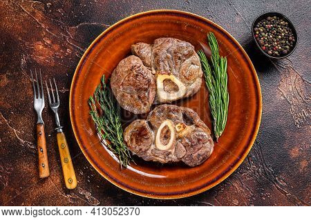 Cooked Meat On The Bone Osso Buco Veal Shank, Italian Ossobuco Steak. Dark Wooden Background. Top Vi