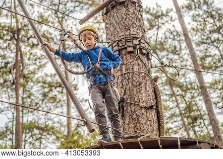Happy Child In A Helmet, Healthy Teenager School Boy Enjoying Activity In A Climbing Adventure Park
