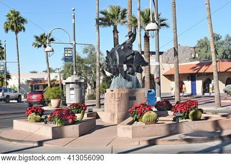 SCOTTSDALE, ARIZONA - DECEMBER 9, 2016: Jack Knife sculpture on Main Street. The bronze statue, by Ed Mell, of a rider on a bucking horse was inspired by the city's official seal.