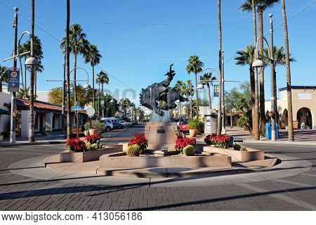 SCOTTSDALE, ARIZONA - DECEMBER 9, 2016: Jack Knife Sculpture on Main Street. By artist Ed Mell, the bronze statue, of a rider on a bucking horse was inspired by the city's official seal.