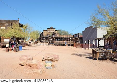 APACHE JUNCTION, ARIZONA - DECEMBER 8, 2016: Goldfield Ghost Town street scene, in Apache Junction, Arizona, off of Route 88. Looking up towards the Mammoth Steakhouse and Saloon.