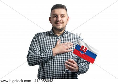 White Guy Holding A Flag Of Slovakia And Holds His Hand On His Heart Isolated On A White Background