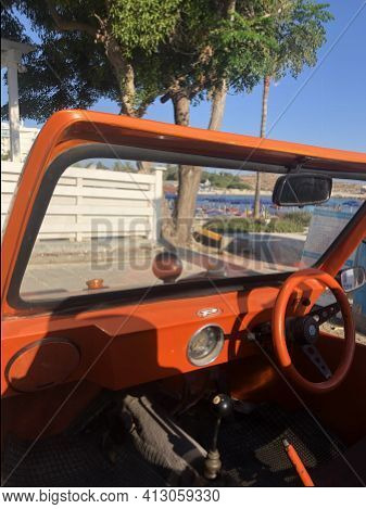 Agia Napa,cyprus- August 8,2019:part Of  The Windshield Of Small Orange Volkswagen Car.very Popular
