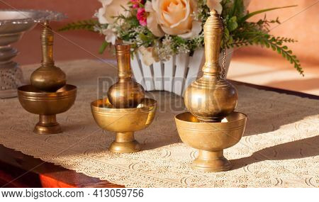 Brass-crafted Utensils Are Used To Contain Water In Buddhist Religious Ceremonies And To Make Merit
