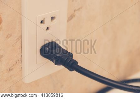 Power Socket And Plug, Electric Outlet With Black Power Cord Cable Into The Wall. Copy Space