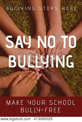 Say no to bullying text against multiple diverse students stacking their hands in the garden. combating racism and bullying template design concept