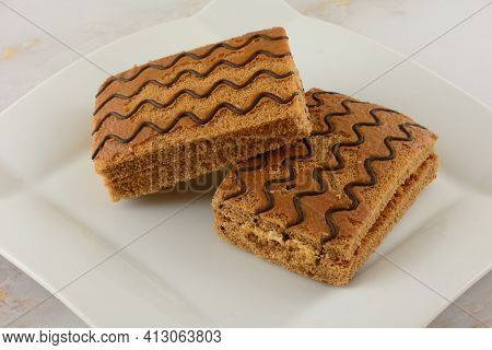 Creme Filled Cake Sandwich With Top Crust Scraped Off And Damaged By Poor Packaging Or Shipping