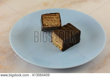Dark Chocolate Almond Layered Wafer Candy Bar Snack On Blue Plate