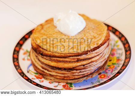 Pancakes With Sour Cream On A White Background
