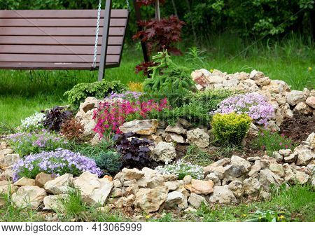 Landscaping Panorama Of Home Garden. Scenery Of Natural Area In Summer. Landscape Design With Stones