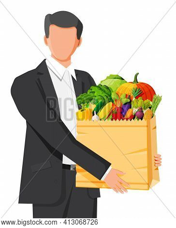 Man Customer With Paper Bag Full Of Fresh Vegetables. Farming Fresh Food, Organic Agriculture Produc