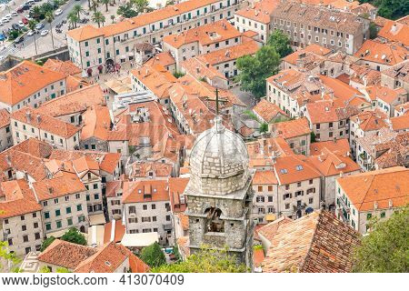 Ariel View Of Church Of Our Lady Of Remedy With Old Town In The Background, Kotor, Montenegro.