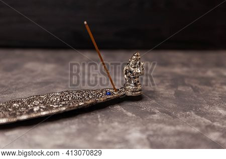 Procedure Aromatherapy. The Concept Of Zen And Meditation. Incense Stick Burning On A Metal Stand. I