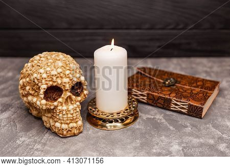 Still Life With Scary Skull, Antique Book And Black Candles. Witchcraft Ritual, Fortune-telling For