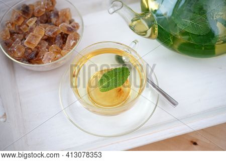Fresh Brewed Mint Tea On Tray With Teacup Teapot And Candi Sugar Healthy Living