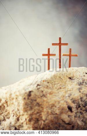 Three Wooden Cross On Calvary Hill, Grey Background. Crucifixion, Resurrection Of Jesus Christ. Chri