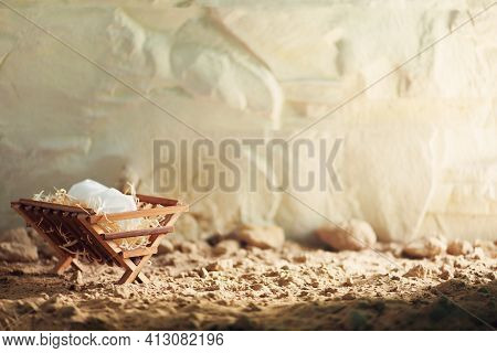 Christian Christmas Concept. Birth Of Jesus Christ. Wooden Manger In Cave Background. Banner, Copy S
